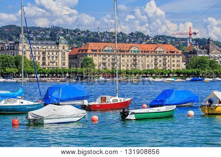 Zurich, Switzerland - 26 May, 2016: boats on Lake Zurich. Lake Zurich (German: Zurichsee) is a lake in Switzerland extending southeast of the city of Zurich. Zurich is the largest city in Switzerland and the capital of the Swiss canton of Zurich.