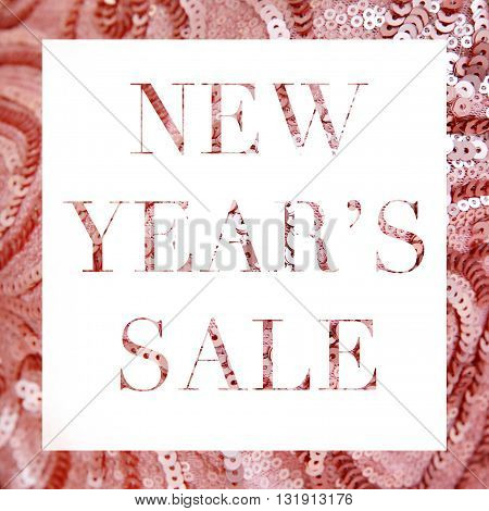 New Year's sale on pale pink sequin background