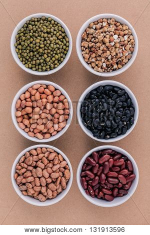 Assortment Of Beans And Lentils In Wooden Spoon Isolate On White  Background. Mung Bean, Groundnut,