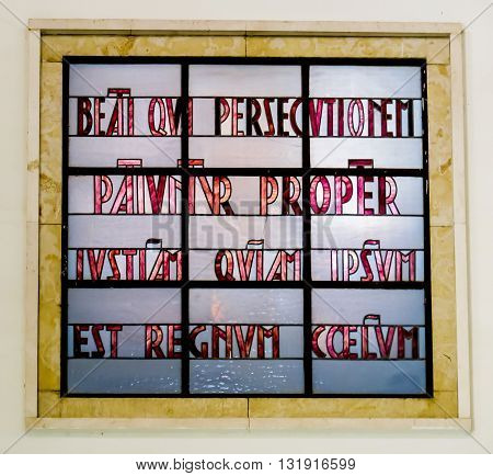 Mount of Beatitudes. Israel. July 9 2015: Blessed are those who are persecuted. Stained glass in the Catholic chapel on Mount of Beatitudes near Tabgha at the Sea of Galilee Israel