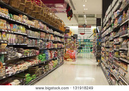 BANGKOK - NOVEMBER 19 2013 : Aisle view of a supermarket Siam Paragon in Bangkok Thailand. Siam Paragon is a shopping mall in Bangkok Thailand. It is one of the biggest shopping centres in Asia.