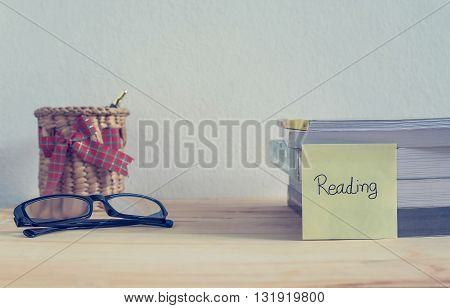 Reading books on the table at home