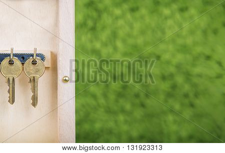 Property insurance and security concept.Wooden Key Holder House with isolated white background