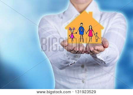 Propriety insurance concept Woman holding hands with a drawn family symbol.Family life insurance family services family policy concept.