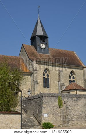 Montreuil sur Epte France - april 21 2015 : the saint Denis gothic church in spring