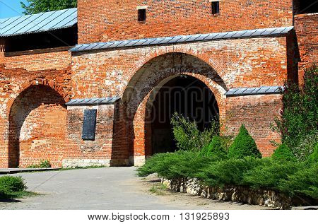 Ancient red brick wall and gate of the medieval fortress - Kremlin in Zaraysk Moscow region