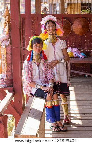 INLE LAKE MYANMAR - JANUARY 14 2016: Two Padaung Tribal women poses for a photo in Inle lake Myanmar Burma The Padaung Karen long-necked tribe woman are minority of Myanmar.