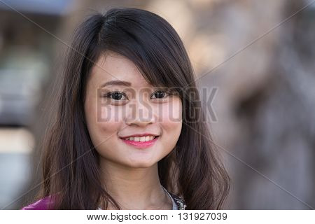 MANDALAY MYANMAR - JANUARY 16 2016: Portrait happy burmese girl in Myanmar Burma. The local people are hospitable and friendly to tourists
