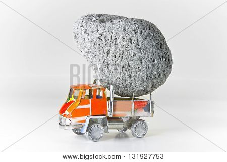 Truck loaded with stones - concept image