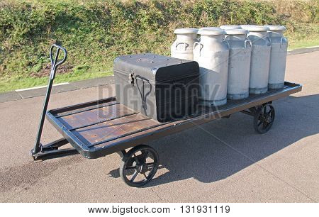 A Classic Railway Platform Trolley with Milk Churns.