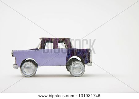 Small old toy car made with metal foil