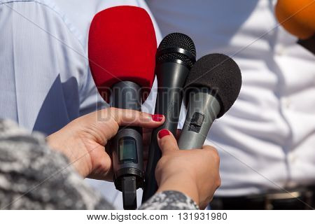 Broadcast journalism. Reporters taking interview at news conference. poster