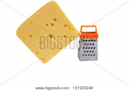Piece of huge cheese and tiny metal grate for preparing grated cheese isolated on white