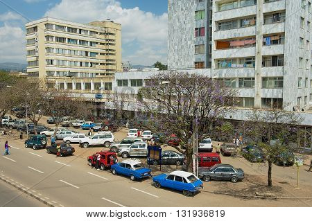 ADDIS ABABA, ETHIOPIA - JANUARY 18, 2010: View to the cars parked at the street in Addis Ababa, Ethiopia.
