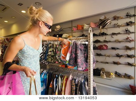 Blong girl buying clothes in a shop poster