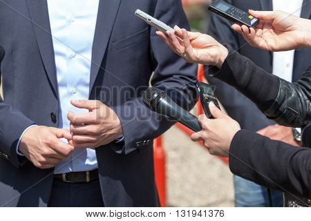 Journalists making interview with businessman or politician