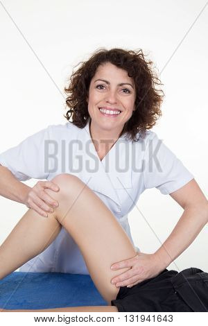Woman Legs While Being Massaged By A Woman Therapist