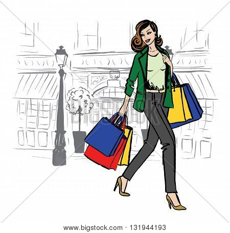 Beautiful woman with shopping bags walking on boutique street