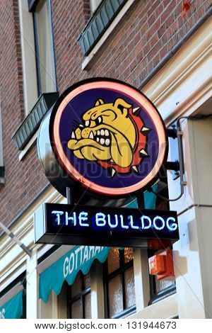 AMSTERDAM, NETHERLANDS - MAY 5, 2016: Bulldog coffeeshop in Amsterdam, Netherlands. Bulldog was the first coffeshop and laid the benchmark for the contemporary coffeeshop.
