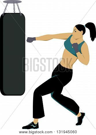 Woman kickboxer training with a punching bag