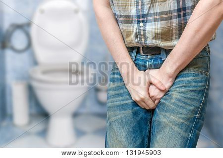 Incontinence Concept. Man Wants To Pee And Is Holding His Bladde