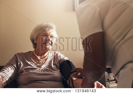 Elderly Woman Getting Routine Check From A Female Doctor