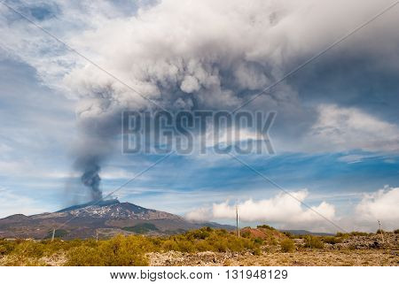 """Strong paroxysm on volcano Etna; ash plume emitted from the summit crater called """"Voragine"""" on 4 December 2015 poster"""