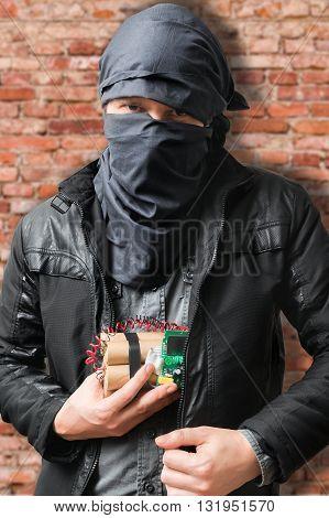 Terrorist Puts Dynamite Bomb In Jacket. Terrorism Concept.