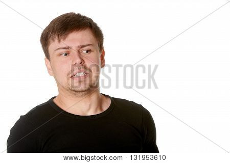 Young man with uncertain puzzled expression on white