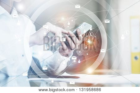 Photo business woman wearing white shirt, sending message smartphone.Open space loft office.Report documents, blurred background.Connections world wide interfaces.Horizontal, flares.Film effect