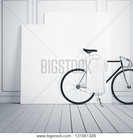 Photo White Room Interior Modern Studio House with Classic bicycle.Empty Canvas on Wood Floor.Blank Tshirt hanging Bike. Square mockup