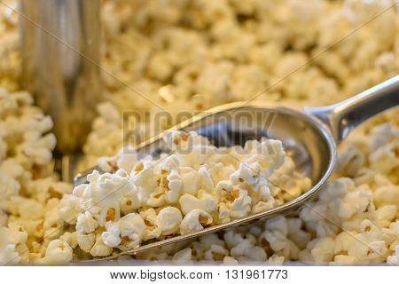 Popcorn in scoop in popcorn machine for sale