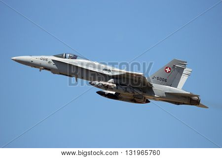 ZARAGOZA SPAIN - MAY 20 2016: Swiss Air Force F-18 Hornet fighter jet taking off from Zaragoza airbase