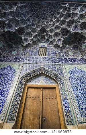door and beautiful blue pattern in sheikh lotfollah mosque in esfahan, iran
