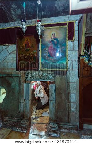 Jerusalem, Israel - February 16, 2013: Tourists Entering Sarcophagus In Tomb Of The Virgin Mary