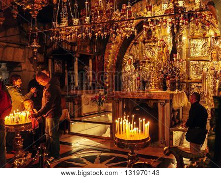 Jerusalem, Israel - February 17, 2013: Pilgrims Praying Near Golgotha Mountain In Temple Of Holy Sep
