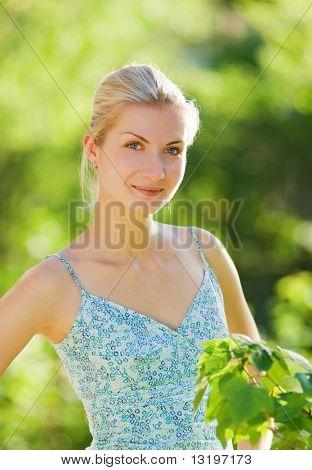 Beautiful blond girl relaxing outdoors