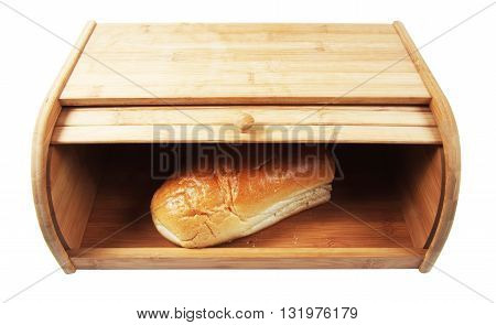 wooden breadbasket with loaf of breas isolated closeup
