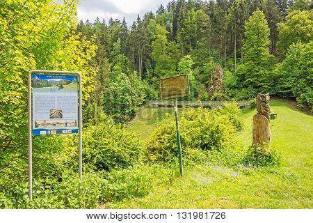 Steinheim Germany - May 26 2016: Wental valley dam - Wental educational trail signpost showing infos about the reservoir dam Swabian Alps (Schwaebische Alb)