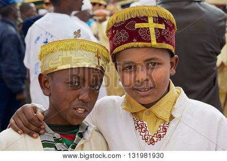 ADDIS ABABA, ETHIOPIA - JANUARY 18, 2010: Portrait of two unidentified Ethiopian boys wearing traditional costumes during Timkat Christian Orthodox religious celebrations in Addis Ababa, Ethiopia.