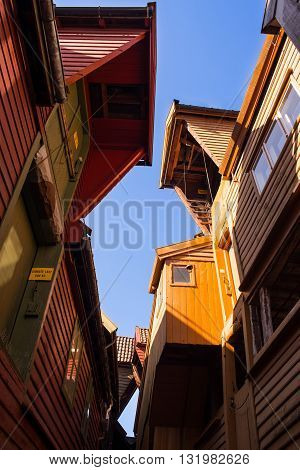 Looking upwards in Bryggen - Hanseatic commercial buildings lining the eastern side of the fjord coming into Bergen, Norway