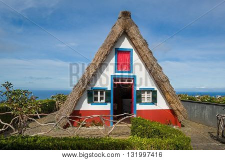 Colorful traditional Madeira island house. popular touristic attraction in the center of Santana town. Madeira, Portugal.