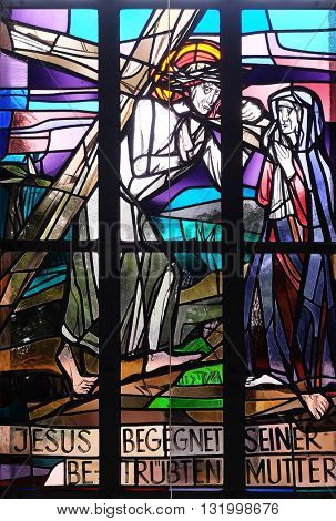 KLEINOSTHEIM, GERMANY - JUNE 08: 4th Stations of the Cross, Jesus meets His Mother, stained glass window in Saint Lawrence church in Kleinostheim, Germany on June 08, 2015.