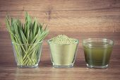 Vintage photo Heap of young powder barley barley grass and beverage on wooden background healthy nutrition and lifestyle body detox poster