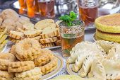 Moroccan tea glasses and biscuit, moroccan food poster