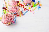 Birthday background with pink cupcakes. Birthday cupcakes. Homemade cupcake. Gourmet cupcakes. Sweet dessert. Sweet pastry. Birthday invitation. Birthday mockup. Styled desktop. Birthday background. poster