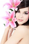 Shot of a young beautiful woman with a lily flowers. Isolated over white background. poster