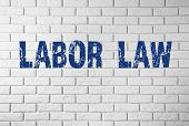 """Labor Law"" text on brick wall poster"