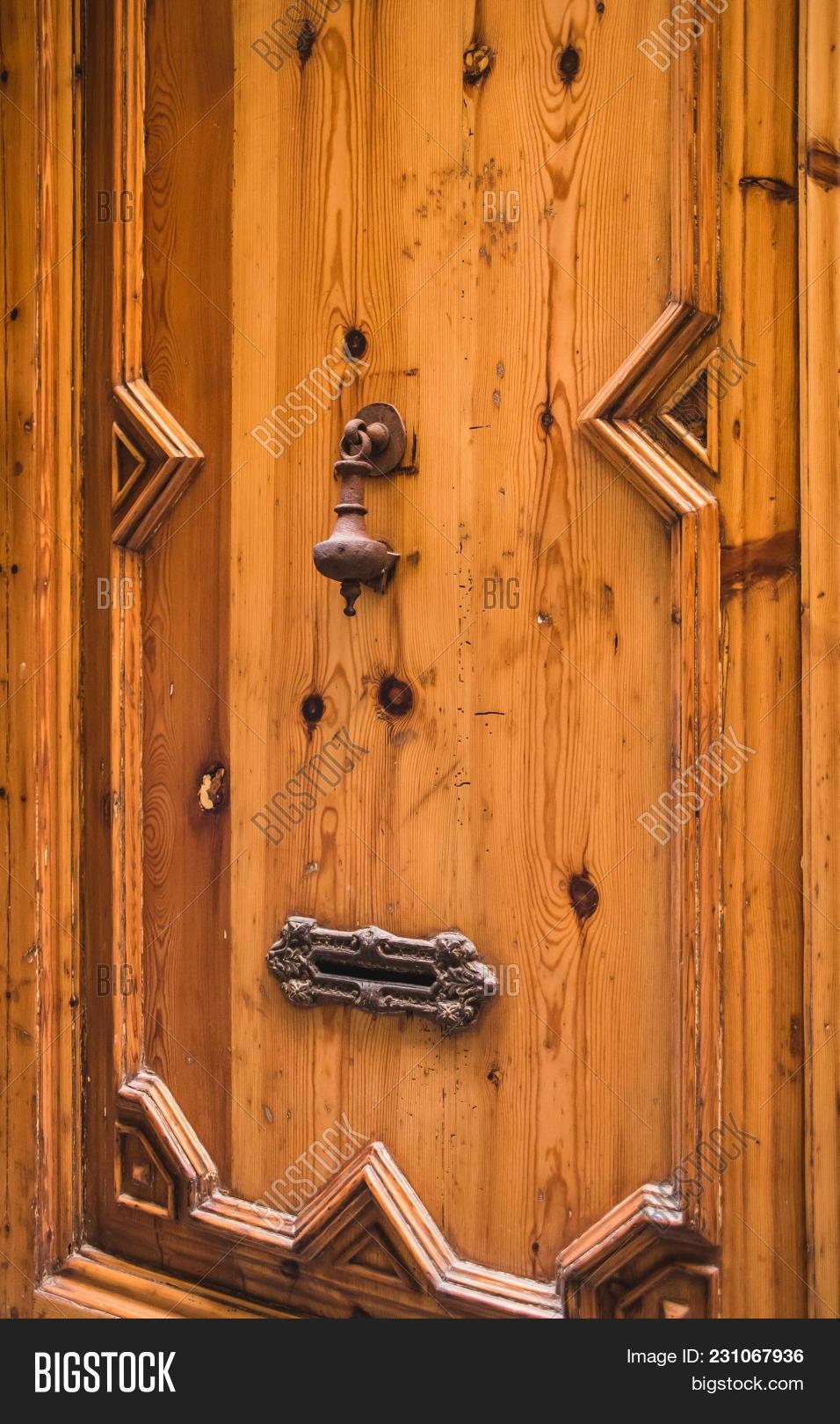 Ancient Rusty Iron Door Knocker On Spanish Church