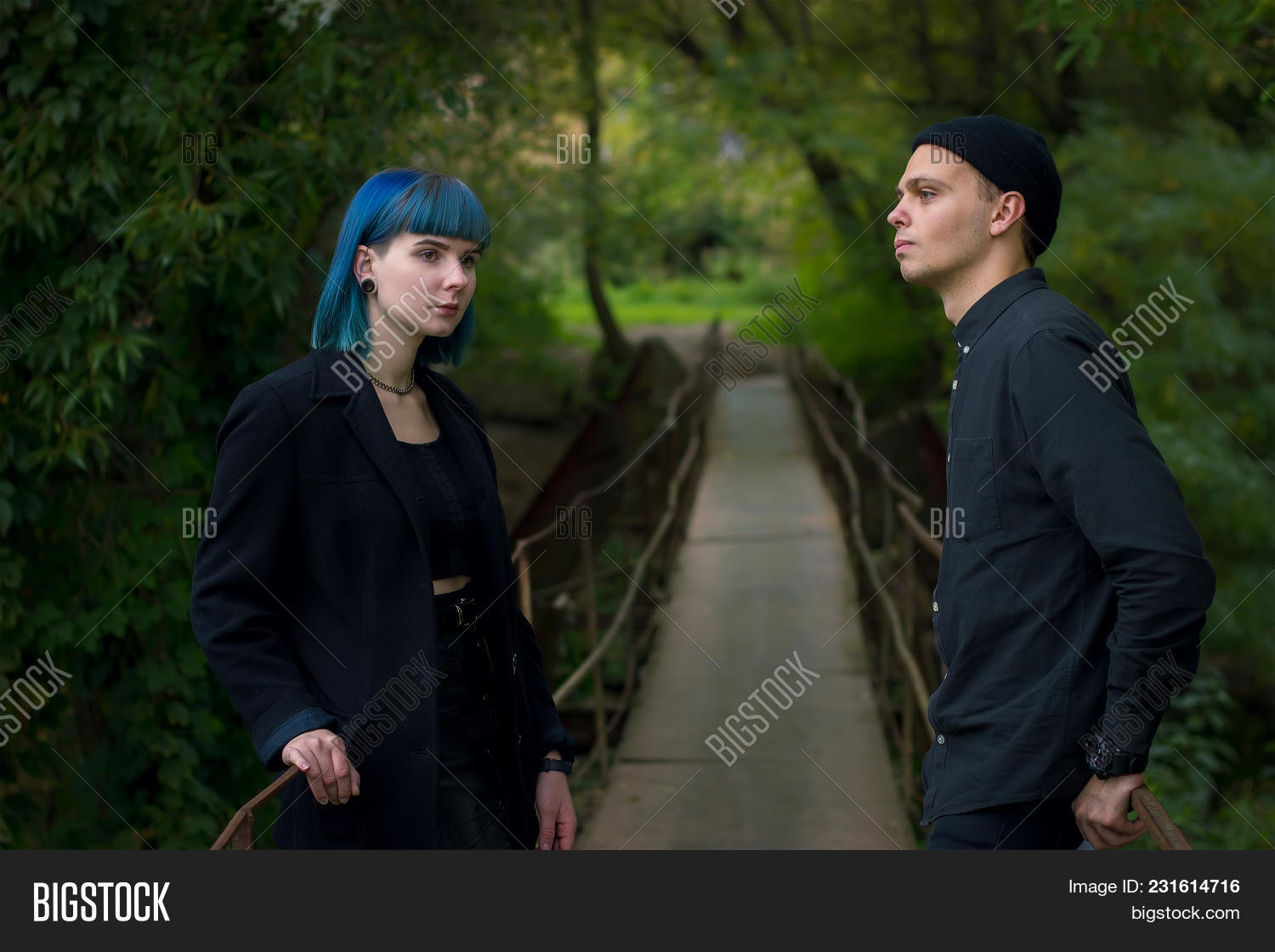 Gothic Couple Outdoors Love Story Man And Blue Hair Girl At Black Clothes Green